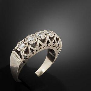 Expertissim - bague jarretière en or et diamants - Bague