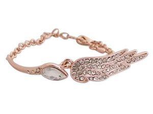 WHITE LABEL - bracelet doré scintillant avec aile d'ange bijou  - Collier