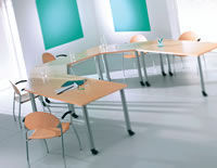 Act Furniture Manufacturers - trapezoids on pole legs with castors - Meeting Table