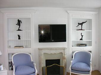 Luc Perron - bibliothèque sur mesure dans niche - Biblioteca